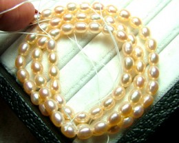 62 CTS PEARL BEAD DRILLED GLOSSY PEACH  TBG-2406