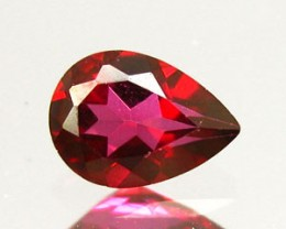 RED AZOTIC TOPAZ .65 CARAT WEIGHT PEAR CUT GEM SPECTACULAR