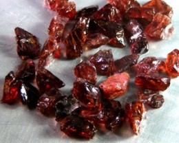 RHODOLITE GARNET 55.80 CARAT WEIGHT PARCEL OF ROUGH EST 35PC