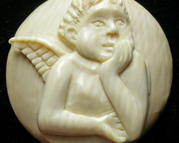 """ANGEL BOY"" MAMMOTH CARVING 25.10 CARATS  RT 459"