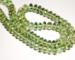 "GREEN AMETHYST faceted beads 7 to 11mm 16"" line"
