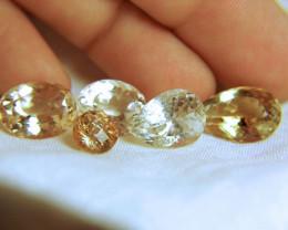 54.29 Tcw. SI Topaz Lot - Pretty, Included Gems - 5 Pcs.
