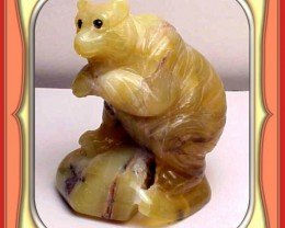 ** 279.5ct Tanzanian Honey Opal Bear Carving **