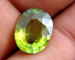 Sphene breaks natural light into color sparks.  Blues, yellows, reds and greens.  Gorgeous effect.