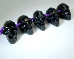 PARCEL OF 5 FACETED BLACK  OBSIDIAN  SKULL  CTS RT 1893