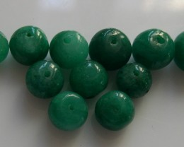 PARCEL OF 11 NATURAL EMERALD BEADS 49,78CTS
