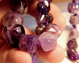 419 Tcw. Amethyst Tumble Stone Strand - Polished Beauty