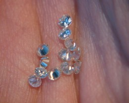 12 natural diamonds .89cttw I~J Si1 2mm faceted round