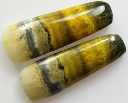 27.40 CTS MUSTARD JASPER PAIR CABOCHONS FROM INDONESIA