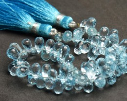 "BLUE TOPAZ faceted briolettes 5mm - 7mm AAA 7"" line"