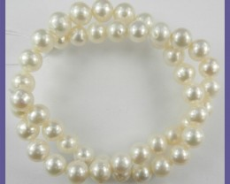 AA++ QUALITY CREAMY WHITE ROUND 9-10.00MM FRESHWATER PEARL STRAND!!