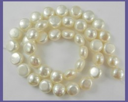 """AA QUALITY CREAMY WHITE 10MM OBLATE/BUTTON FRESHWATER PEARL STRAND!!&"