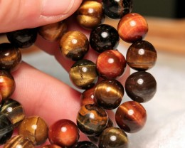293 Tcw. Tiger Eye Strand, 15 inches, 10mm Pcs.