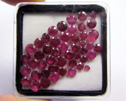 RUBIES PICTURED IN A TRANSPARENT BOX (RUBIES MAY HAVE FLUFFY BITS FROM FOAM IN THE BOX)