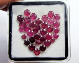 IN THIS PICTURE, RUBIES ARE PHOTOGRAPHED IN A TRANSPARENT BOX (RUBIES MAY HAVE FLUFFY BITS FROM FOAM IN THE BOX)