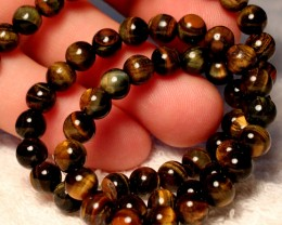 128.5 Tcw. Tiger Eye Strand, 16 inches, 6.5mm