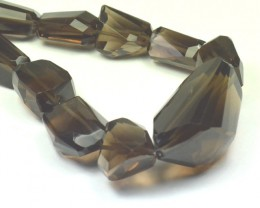 "8"" half line of 37 - 17mm AAA irregular Smokey Quartz beads"