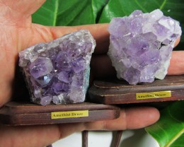 O.258  KILO  TWO AMETHYST SPECIMENS  ON WOOD STAND MS 1916
