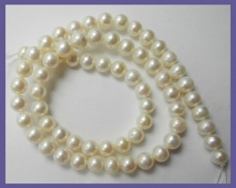 AA+++ QUALITY CREAMY WHITE NEAR ROUND 6.00MM FRESHWATER PEARL STRAND
