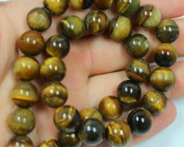 425 CTS - 1 STRAND TIGER EYE 14MM ROUND BEAD 15INCH LENGHT