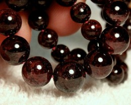 244 Tcw. 17 Inch Spessartite Garnet Strand - 5mm to 10mm