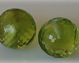 2 PERIDOT FACETTED SPHERES (DRILLED FOR EARRINGS) 5.07cts