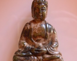 FROM A COLLECTION GREEN/BROWN JADE CARVING BUDDHA