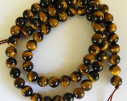 BEAUTIFULLY CHATOYANT NATURAL 6-6.5MM ROUND RED TIGER EYE BEADS!!
