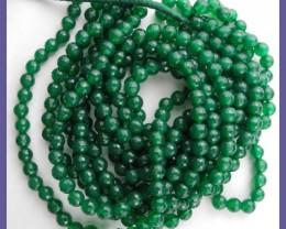 AA 6.00MM TRANSLUCENT GREEN ONYX ROUND FACETED BEAD STRAND