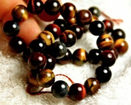 293 Tcw China Tiger Eye Strand - 10mm / 15.5 inches
