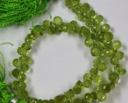 60 CTS - 1 STRAND PERIDOT 3 X 3 MM BEAD 8 INCHES