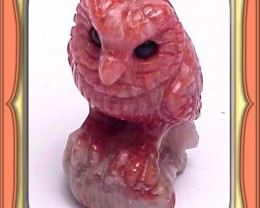 CARVING-63.65ct. Fosslized Red Horn Coral Carved Owl