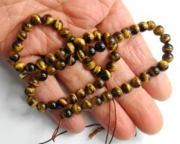 BEAUTIFULLY CHATOYANT NATURAL 6-6.5MM ROUND TIGER EYE BEADS