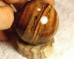 1732 Tcw. 56mm Tiger Eye Sphere with Agate Stand
