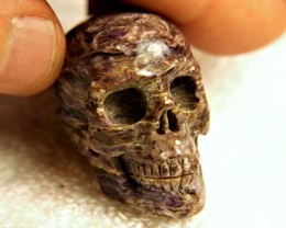 Carved Charoite Skull - 170 Carats - 33mm