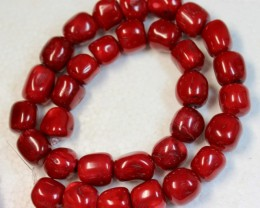 549 CTS RED CORAL STRAND OF BEADS