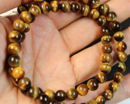 119 CTS  -  TIGER EYE NATURAL POLISHED BEAD STRAND