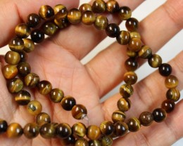 113 CTS  -  TIGER EYE NATURAL POLISHED BEAD STRAND