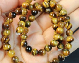 111 CTS  -  TIGER EYE NATURAL POLISHED BEAD STRAND