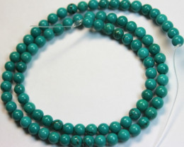 61.6 CTS ONE NATURAL STRAND OF TURQUOISE POLISHED BEADS P972