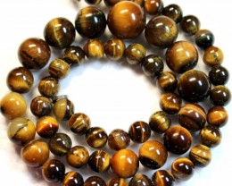 300.9 CTS  -  TIGER EYE NATURAL POLISHED ROUND BEAD WITH CLASP P1001