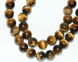TIGERS EYE BEADS - 146 CARATS
