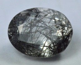 oval black Rutile Tourmalated Quartz faceted gem