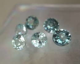 A PARCEL OF 6 PALE BLUE ZIRCON GEMS 4MM