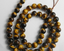 CHATOYANT NATURAL 6-6.50MM ROUND TIGER EYE BEADS