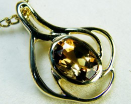CHAMPAGE TOPAZ SET IN 14 K GOLD PENDANT    MY 308