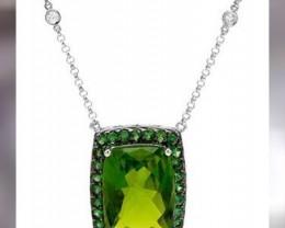 Peridot 14.65cts - 22ctWhite Gold - Diamonds & Tsav Garnets