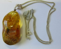 56 cts polished amber with bale AGR679