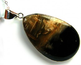 PALM ROOT  FOSSIL SET IN  PENDANT 60  CARATS  AAA1906