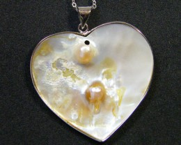 NATURAL PEARL SHELL WITH PEARL FORMED 52.90 CTS AG 808